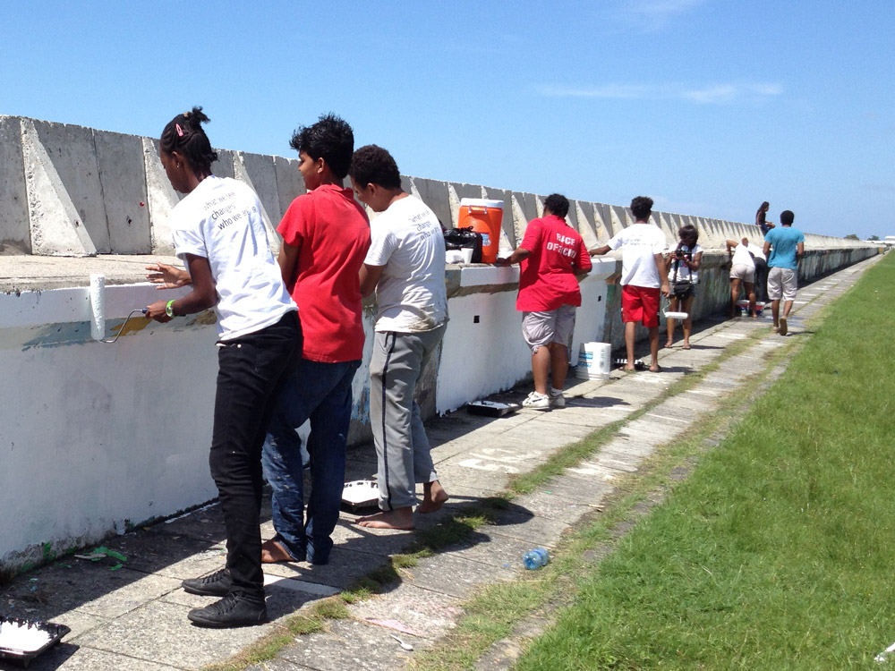 StencilProject painting the sea wall